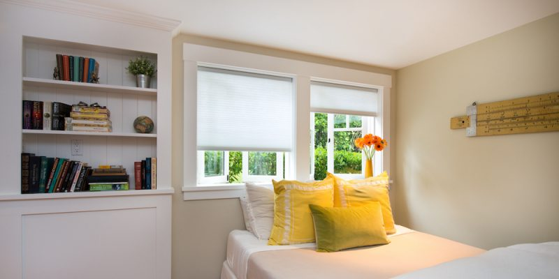 Artisan Select Light Filtering White Shades in a bedroom
